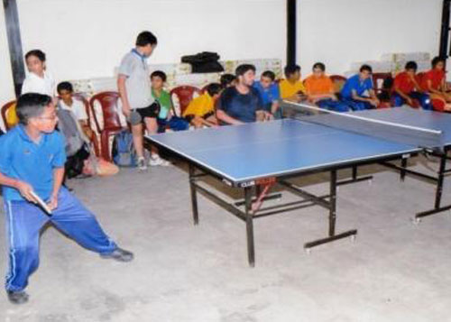 Students having a competitive session during a Table Tennis and Badminton practice in Indoor Sports Complex.